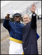 President George W. Bush celebrates with an unidentified graduate Wednesday, May 28, 2008, during commencement exercises at the United States Air Force Academy in Colorado Springs. White House photo by Eric Draper