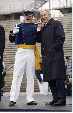 "President George W. Bush shares a phone conversation with a graduate of the United States Air Force Academy Wednesday, May 28, 2008, after commencement ceremonies in Colorado Springs. The President told the class of 2008, ""You're the 50th graduating class in the history of the Air Force Academy. Each of you has worked hard to reach this moment. I'll leave this campus today filled with the confidence in the course of our struggle and the fate of our country, because I've got confidence in each of you."" White House photo by Eric Draper"