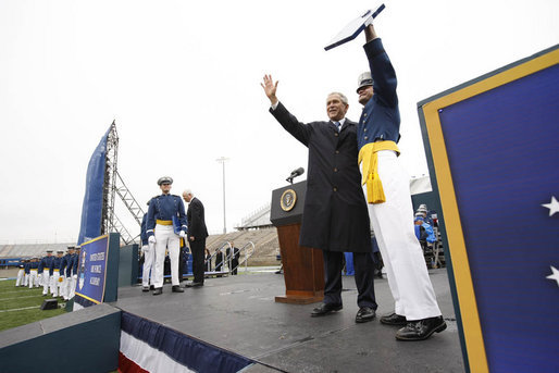 President George W. Bush and a graduate of the United States Air Force Academy wave to family and friends in the audience Wednesday, May 28, 2008, during graduation ceremonies for the Class of 2008 in Colorado Springs. The class of 1,012 cadets is the 50th to graduate from the Academy. White House photo by Eric Draper