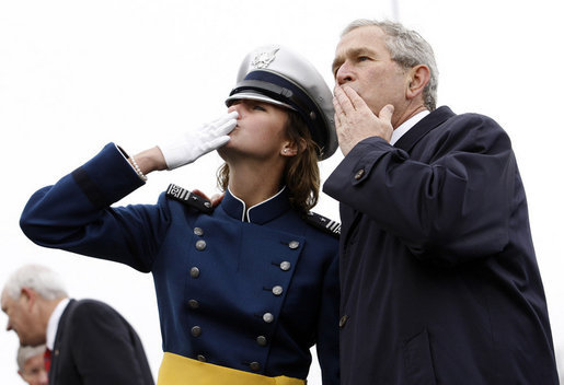 President George W. Bush shares in blowing a kiss to family and friends of a Class of 2008 graduate of the United States Air Force Academy Wednesday, May 28, 2008, during commencement ceremonies in Colorado Springs. Out of the 1, 012 cadets to graduate, 18 percent are women. White House photo by Eric Draper