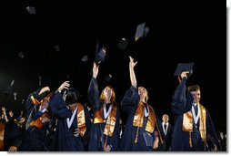 Graduates of Enterprise High School's Class of 2008 toss their caps into the air Thursday, May 29, 2008, during commencent exercises at the Alabama high school. Mrs. Laura Bush was on hand to deliver the commencement address to the class that lost four of its members in the 2007 tornadoes that devastated the city.  White House photo by Shealah Craighead