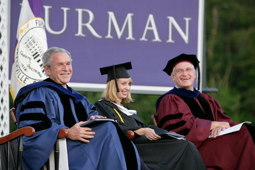 President George W. Bush shares a laugh with Furman University Student Commencement Speaker Meredith Neville and the Chairman of Furman University Board of Trustees Carl Kohrt during commencement ceremonies for the Class of 2008 at Furman University in Greenville, SC. White House photo by Chris Greenberg