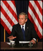 "President George W. Bush delivers remarks during a drop-by meeting on the economy and tax cuts Monday, June 2, 2008, in the Dwight D. Eisenhower Executive Office Building in Washington, D.C. President Bush said during his remarks, ""The best way to deal with economic uncertainty is to let people have more of their own money, because we believe that the economy benefits when there's more money in circulation, in the hands of the people who actually earned it."" White House photo by Joyce N. Boghosian"