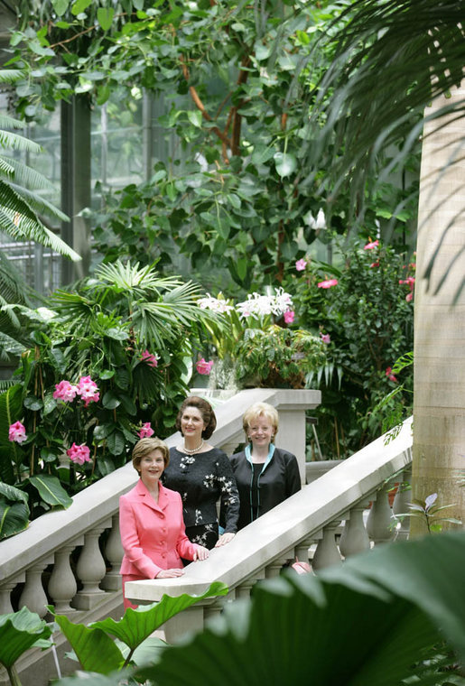 Mrs. Laura Bush stands with Lynda Bird Johnson Robb, center, and Mrs. Lynne Cheney inside the United States Botanic Garden in Washington, D.C., at the Senate Spouses' Luncheon Tuesday, June 3, 2008. White House photo by Shealah Craighead