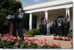 President George W. Bush delivers remarks during a visit to the White House Tuesday, June 3, 2008, by the University of Kansas Jayhawks, winners of the 2008 NCAA Men's Basketball Championship.  White House photo by David Bohrer