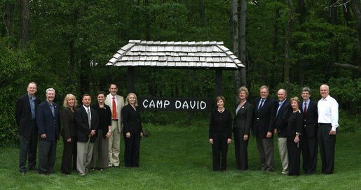 Mrs. Laura Bush poses with directors of the Presidential Libraries Wednesday, June 4, 2008, during their visit to Camp David in Thurmont, Maryland. White House photo by Shealah Craighead