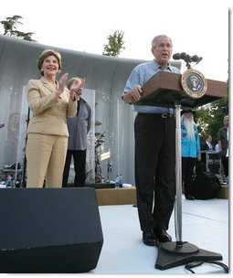 President George W. Bush and Laura Bush are seen on stage as they welcome guests to the annual Congressional Picnic on the South Lawn of the White House, Thursday evening, June 5, 2008, hosted for members of Congress and their families. White House photo by Shealah Craighead