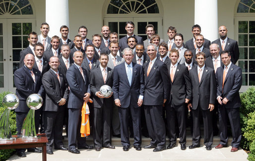 President George W. Bush poses for a photo with the 2007 Major League Soccer Cup Champions, the Houston Dynamo Thursday, June 5, 2008, in the Rose Garden at the White House. White House photo by Joyce N. Boghosian