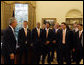 President George W. Bush gives the 2007 Major League Soccer Cup Champions, the Houston Dynamo, a tour of the Oval Office Thursday, June 5, 2008, during their visit to the White House. White House photo by Joyce N. Boghosian