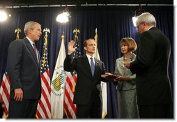 President George W. Bush looks on as White House Chief of Staff Joshua Bolten administers the oath of office to Secretary of Housing and Urban Development Steve Preston, Friday, June 6, 2008 in Washington, D.C. Holding the Bible for the ceremonial swearing-in is Molly Preston, wife of Secretary Preston. White House photo by Joyce N. Boghosian