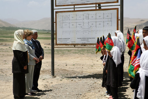 Mrs. Laura Bush is greeted by future students of the Ayenda Learning Center during her visit to the school's construction site Sunday, June 8, 2008, in Bamiyan, Afghanistan. Joining Mrs. Bush is Governor of Bamiran Province Habiba Sarabi, left, and Ihsan Ullah Bayat, who directed a tour of the site. White House photo by Shealah Craighead