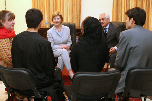 Mrs. Laura Bush is joined by Afghan Foreign Minister Rangeen Dadfar Spanta, center right, for a meeting with Afghan teachers and students, Sunday, June 8, 2008, during an unannounced visit to Kabul. Attending the meeting were representatives from Kabul University, American University of Afghanistan, International School of Kabul and the Women's Teacher Training Institute. White House photo by Shealah Craighead
