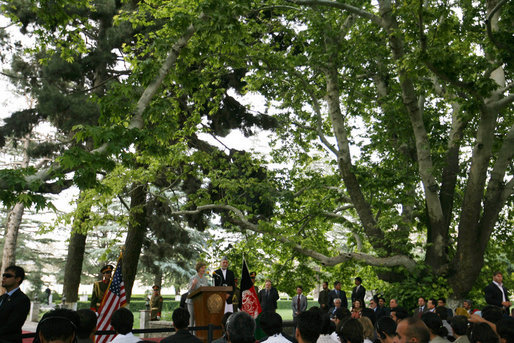 Under the boughs of the trees of Gul Khana Palace, Mrs. Laura Bush delivers remarks Sunday, June 8, 2008, during a press availability with President Hamid Karzai of Afghanistan in Kabul. White House photo by Shealah Craighead