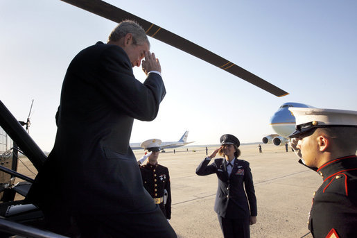 President George W. Bush gives a salute upon his arrival to Andrews Air Force Base Monday, June 9, 2008, before boarding Air Force One on a week-long trip to Europe. White House photo by Eric Draper