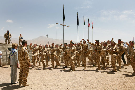 Mrs. Laura Bush is greeted Sunday, June 8, 2008, by New Zealand troops performing a traditional warrior dance at the Bamiyan Provincial Reconstruction Team Base in Afghanistan's Bamiyan province. Standing with her is Major Justin de la Haye. White House photo by Shealah Craighead