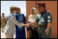 Governor Habiba Sarabi, center, introduces Mrs. Laura Bush to Col. Hafizullah Paymon, Commander of the Afghan Regional Training Center, during a visit to the Police Training Academy in Bamiyan, Afghanistan there Sunday, June 8, 2008. White House photo by Shealah Craighead