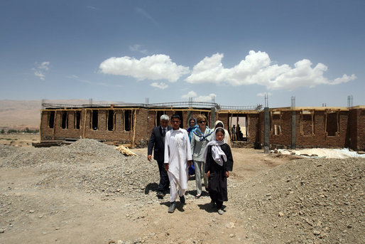 Mrs. Laura Bush is joined by Governor of Bamiran Province, Habiba Sarabi, right, and students, during a tour of the future site of the Ayenda Learning Center Sunday, June 8, 2008, in Bamiyan, Afghanistan.The tour was led by Ihsan Ullah Bayat, far left. Once completed, the Ayenda Learning Center will provide a safe and nurturing environment for 128 of Bamiyan most disadvantaged children to live. At the same time, it will provide educational opportunities for as many as 210 children in the region. White House photo by Shealah Craighead