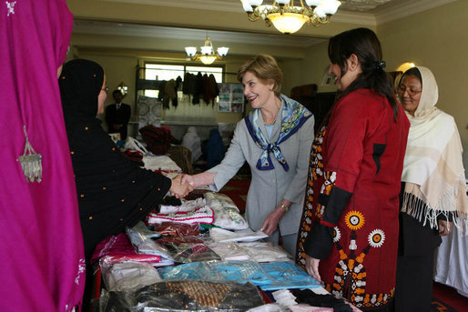 Mrs. Laura Bush greets local businesswomen as she tours the marketplace of the Arzu and Bamiyan Women's Business Association on June 9, 2008 in Afghanistan. The carpets, embroidery and other Afghan wares are all made by women. White House photo by Shealah Craighead