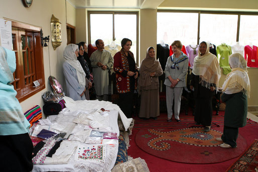 Mrs. Laura Bush speaks with Afghan women entrepreneurs during her visit to the marketplace of Arzu and Bamiyan Women's Business Association Sunday, June 8, 2008, in Afghanistan. White House photo by Shealah Craighead