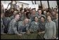 Mrs. Laura Bush poses for a photo with US troops during her visit to Bagram Air Force Base Sunday, June 8, 2008, in Bagram, Afghanistan. White House photo by Shealah Craighead
