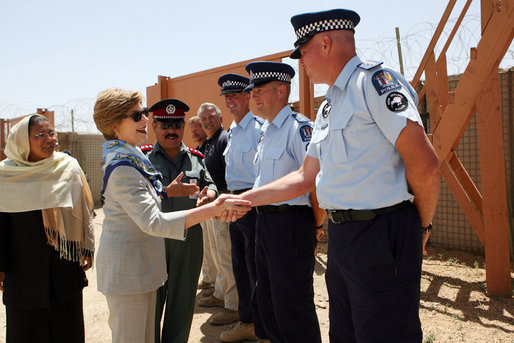 Mrs. Laura Bush greets New Zealand Police officers Sunday, June 8, 2008, during her visit to the Police Training Academy in Bamiyan, Afghanistan. Mrs. Bush traveled to Afghanistan to highlight the continued U.S. commitment to the country and its President Hamid Karzai. White House photo by Shealah Craighead