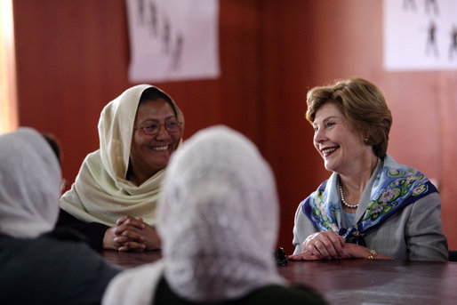 Mrs. Laura Bush smiles as she meets Sunday, June 6, 2008, with female graduates of the Police Training Academy in Bamiyan province in Afghanistan. With her is Bamiyan Governor Habiba Sarabi. White House photo by Shealah Craighead