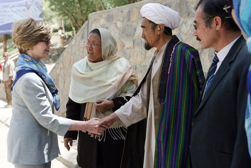 Mrs. Laura Bush meets with local leaders as she arrives June 9, 2008 at the Bamiyan Bazaar in Afghanistan to inaugurate work on the road project. White House photo by Shealah Craighead