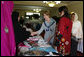 Mrs. Laura Bush greets local businesswomen as she tours the marketplace of the Arzu and Bamiyan Women's Business Association on June 8, 2008 in Afghanistan. The carpets, embroidery and other Afghan wares are all made by women. White House photo by Shealah Craighead