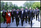 President George W. Bush, center, walks with a delegation of European Union leaders, Tuesday, June 10, 2008 at Brdo Castle in Kranj, Slovenia. From left are, Benita Ferrero-Waldner, commissioner for External Relations and European Neighborhood Policy; European Commission President Jose Manuel Barroso; Slovenia Prime Minister Janez Jansa; and Dimitrij Rupel, Slovenia Minister for Foreign Affairs, background right. White House photo by Eric Draper