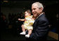 President George W. Bush smiles as he holds a baby during his visit to the United States Embassy Tuesday, June 10, 2008, in Kranj, Slovenia. White House photo by Chris Greenberg
