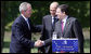 President George W Bush shakes hands with Janez Jansa, Prime Minister of Slovenia, and Jose Manuel Barroso, President of the European Commission, following the United States - European Union Meeting Tuesday, June 10, 2008, at Brdo Castle in Kranj, Slovenia. White House photo by Chris Greenberg