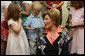 Mrs. Laura Bush talks to children during her visit to the United States Embassy Tuesday, June 10, 2008, in Kranj, Slovenia. White House photo by Chris Greenberg
