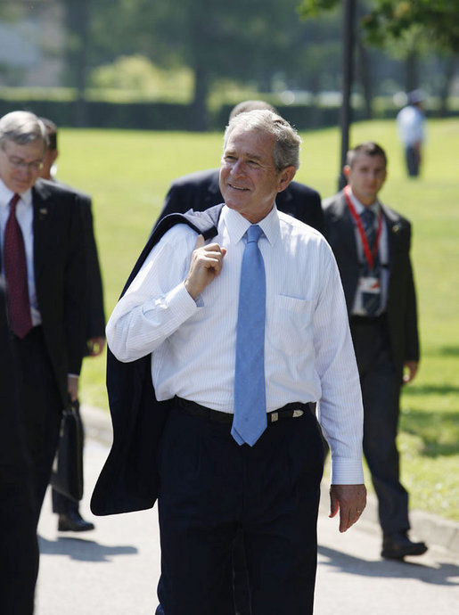 President George W. Bush walks carrying his jacket over his shoulder on his way to a meeting with European Union leaders Tuesday, June 10, 2008 at Brdo Castle in Kranj, Slovenia. White House photo by Eric Draper