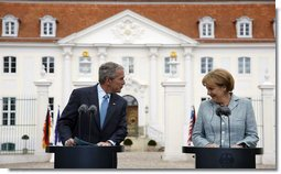 President George W. Bush and Germany's Chancellor Angela Merkel are seen together during a joint press availability Wednesday, June 11, 2008, at Schloss Meseberg in Meseberg, Germany. White House photo by Eric Draper