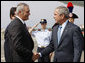 President George W. Bush shakes hands with U.S. Ambassador to Italy Ronald Spogli after arriving Wednesday, June 11, 2008, at Ciampino International Airport in Rome. White House photo by Eric Draper