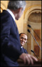 A smiling Italian Prime Minister Silvio Berlusconi listens as President George W. Bush addresses reporters at their joint press availability Thursday, June 12, 2008, at the Villa Madama in Rome. White House photo by Eric Draper