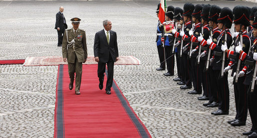 President George W. Bush is escorted by Italian General Rolando Mosca Moschini as he reviews the Guardia D'Onore Thursday, June 12, 2008, on his arrival to the Quirinale Palace in Rome. White House photo by Eric Draper