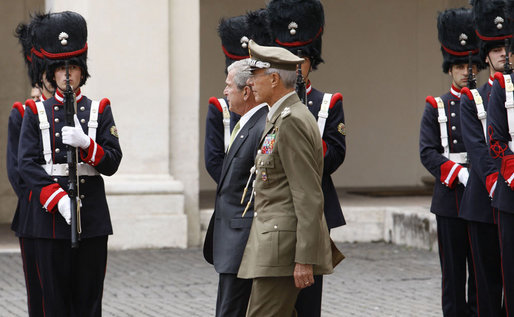 President George W. Bush, escorted by Italian General Rolando Mosca Moschini, passes the Guardia D'Onore Thursday, June 12, 2008, on his departure from Quirinale Palace in Rome. White House photo by Eric Draper
