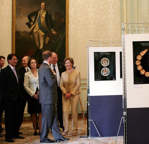 Mrs. Laura Bush participates in a viewing of the National Geographic Exhibits on Afghanistan led by Dr. Fredrick Hiebert, Archaeologist and Curator, National Geographic, Wednesday, June 11, 2008, during her visit to the Ambassador's Residence in Paris. Mrs. Bush is joined by U.S. Ambassador to France, Craig Stapleton, and his wife, Dorothy Stapleton. White House photo by Shealah Craighead
