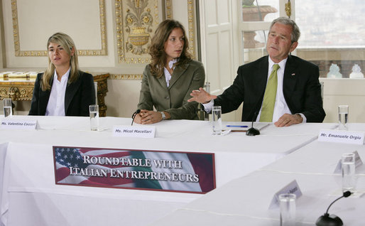 President George W. Bush gestures as he addresses participants at a roundtable meeting on business exchanges between Italy and the United States Thursday, June 12, 2008, at the Villa Aurelia in Rome. President Bush is seated next to entrepreneurs Valentina Coccoli, left, and Micol Macellari, center. White House photo by Chris Greenberg