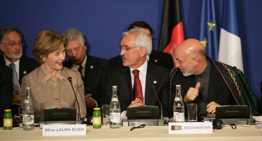 Mrs. Laura Bush, seated next to Afghanistan Foreign Minister Dr. Rangin Dadfar Spanta, speaks with Afghanistan President Hamid Karzai, right, during the International Conference in Support of Afghanistan Thursday, June 12, 2008, in Paris. White House photo by Shealah Craighead