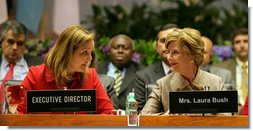 Mrs. Laura Bush sits with United Nations' World Food Program Executive Director Josette Sheeran during the plenary session at the WFP conference in Rome on June 12, 2008. President Bush is also in Italy for three days. White House photo by Shealah Craighead