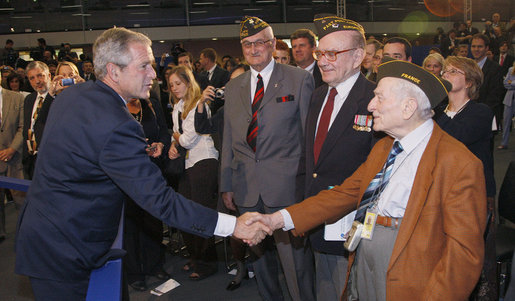 President George W. Bush meets with World War II veterans following his address to the Organization for Economic Co-operation and Development Friday, June 13, 2008, in Paris, honoring the strong relationship between the United States and Europe. White House photo by Eric Draper
