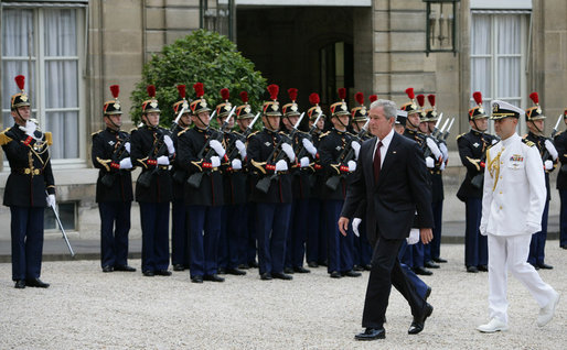 President George W. Bush reviews an honor guard as he arrives to meet French President Nicolas Sarkozy for a dinner Friday evening, June 13, 2008, at the Elysee Palace in Paris. White House photo by Chris Greenberg