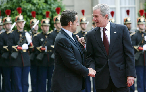 President George W. Bush is welcomed by French President Nicolas Sarkozy for a dinner Friday evening, June 13, 2008, at the Elysee Palace in Paris. White House photo by Chris Greenberg