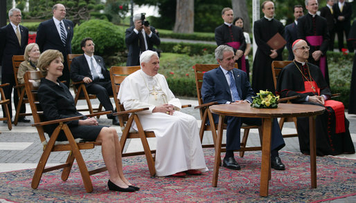 President George W. Bush and Mrs. Laura Bush meet June 13, 2008 in the Vatican Gardens with Pope Benedict XVI and Vatican Secretary of State Cardinal Tarcisio Bertone, where they watch the performance of The Pontifical Sistine Choir. White House photo by Shealah Craighead