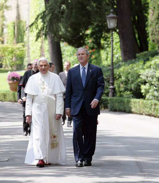 President George W. Bush joins Pope Benedict XVI on a walk through the Vatican Gardens Friday, June 13, 2008 at the Vatican. White House photo by Chris Greenberg
