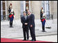 President George W. Bush is welcomed by French President Nicolas Sarkozy for a dinner Friday evening, June 13, 2008, at the Elysee Palace in Paris. White House photo by Eric Draper