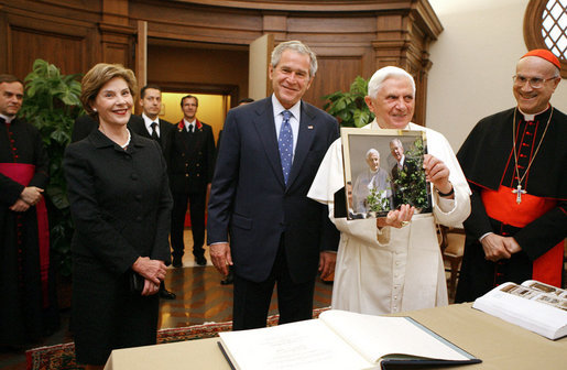 President George W. Bush and Laura Bush present Pope Benedict XVI with a framed photograph Friday, June 13, 2008, during their visit to the Vatican. The photo shows President Bush and Pope Benedict XVI together at the White House during the Pope's visit in April. White House photo by Shealah Craighead