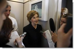Mrs. Laura Bush speaks with members of the press June 13, 2008 aboard Air Force One, as she and President Bush travel from Rome to Paris on their multi-city European visit.  White House photo by Eric Draper